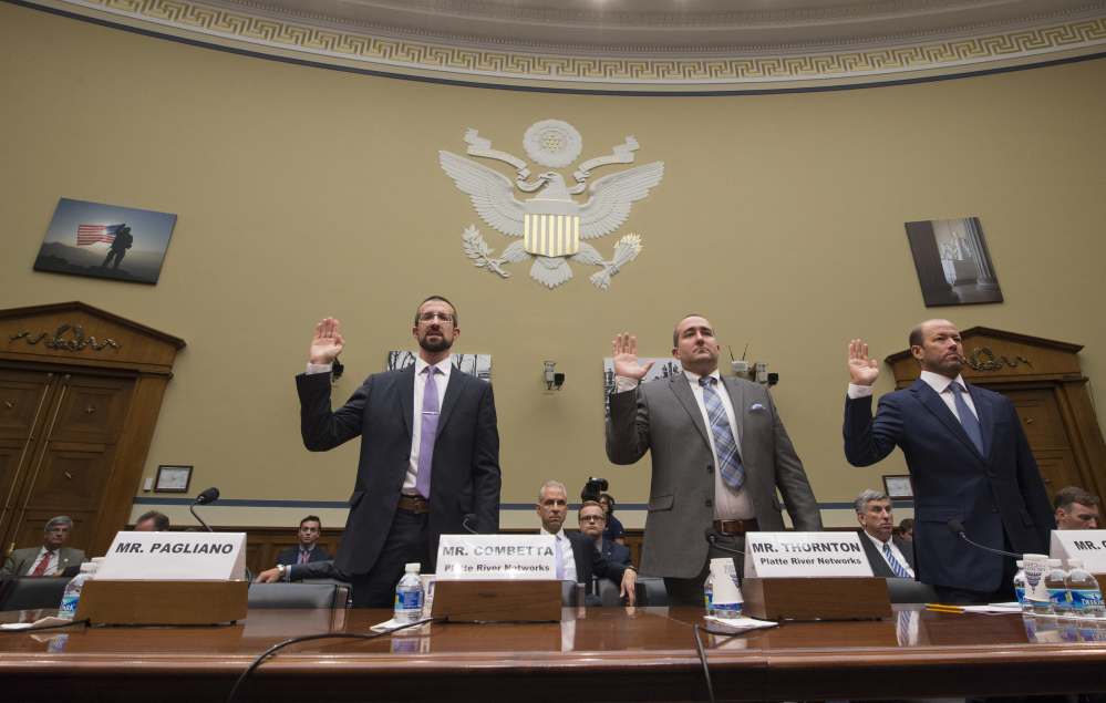 Witnesses, from left, Paul Combetta, Platte River Networks, Bill Thornton, Platte River Networks, and Justin Cooper are sworn in on Capitol Hill in Washington prior to testifying before the House Oversight and Government Reform Committee hearing on 'Examining Preservation of State Department Records.' Bryan Pagliano, former senior advisrr, Information Resource Management, Department of State did not appear.