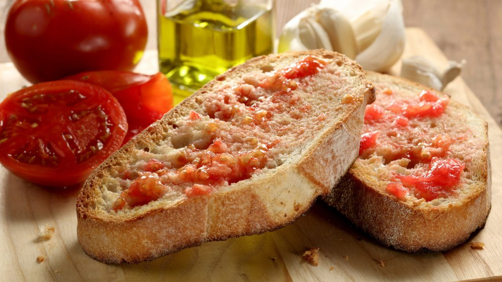 Pan de tomate is a simple way to savor the flavor.