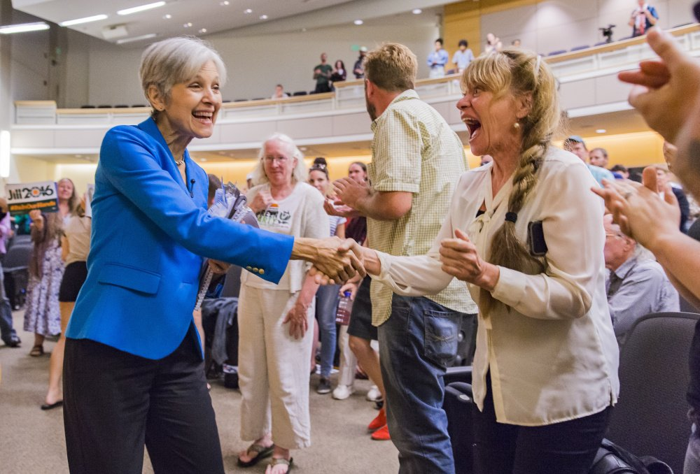 Green Party presidential nominee Jill Stein, left, greets Debra Walton at USM Wednesday night, where she told about 200 people she would tax Wall Street to pay off student loan debt.