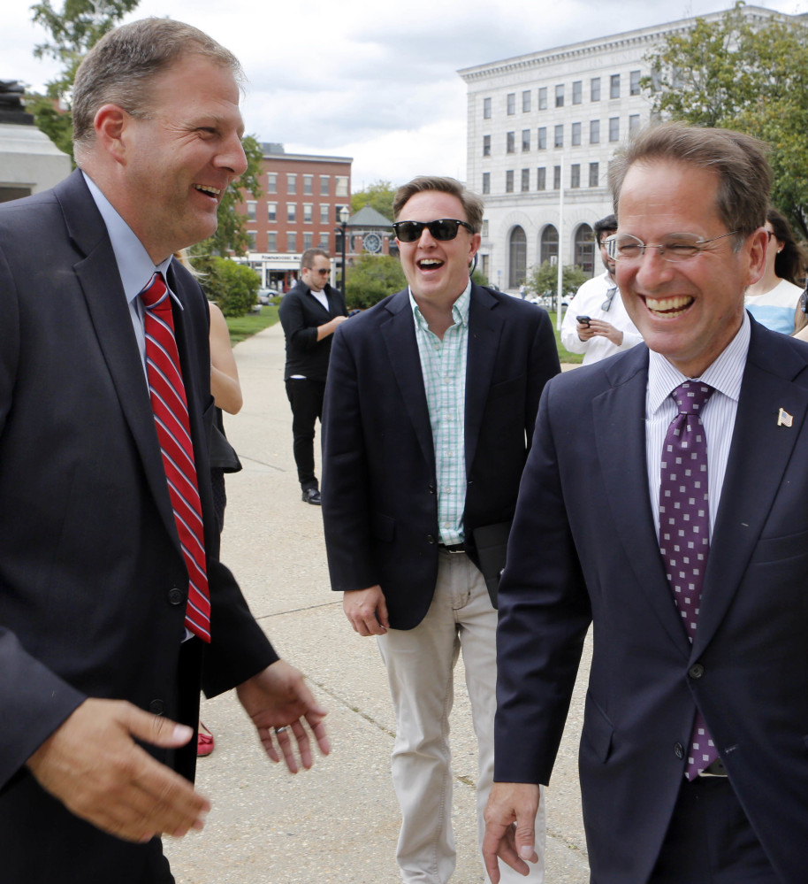 Republican gubernatorial candidates Executive Councilor Chris Sununu, left, and state Rep. Frank Edelblut joke Wednesday outside the Statehouse in Concord, N.H. Edelblut conceded the race for the Republican nomination for governor after Sununu won by fewer than 1,000 votes. He will run against his Democratic primary winner fellow Executive Councilor Colin Van Ostern.  (AP)