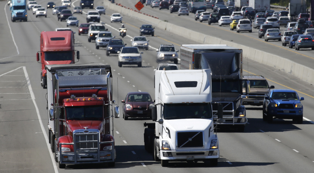 The federal government says that slower tractor-trailers could mean safer highways, and proposes electronic speed limiters on trucks and buses weighing over 26,000 pounds.