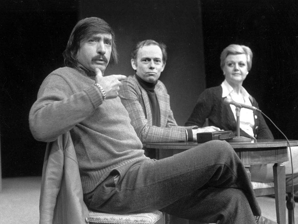 Edward Albee, left, makes a point as director Paul Weidner and actress Angela Lansbury look on during a news conference in Hartford, Conn., in January 1977. Albee continued to write provocative and unconventional plays into his 70s.