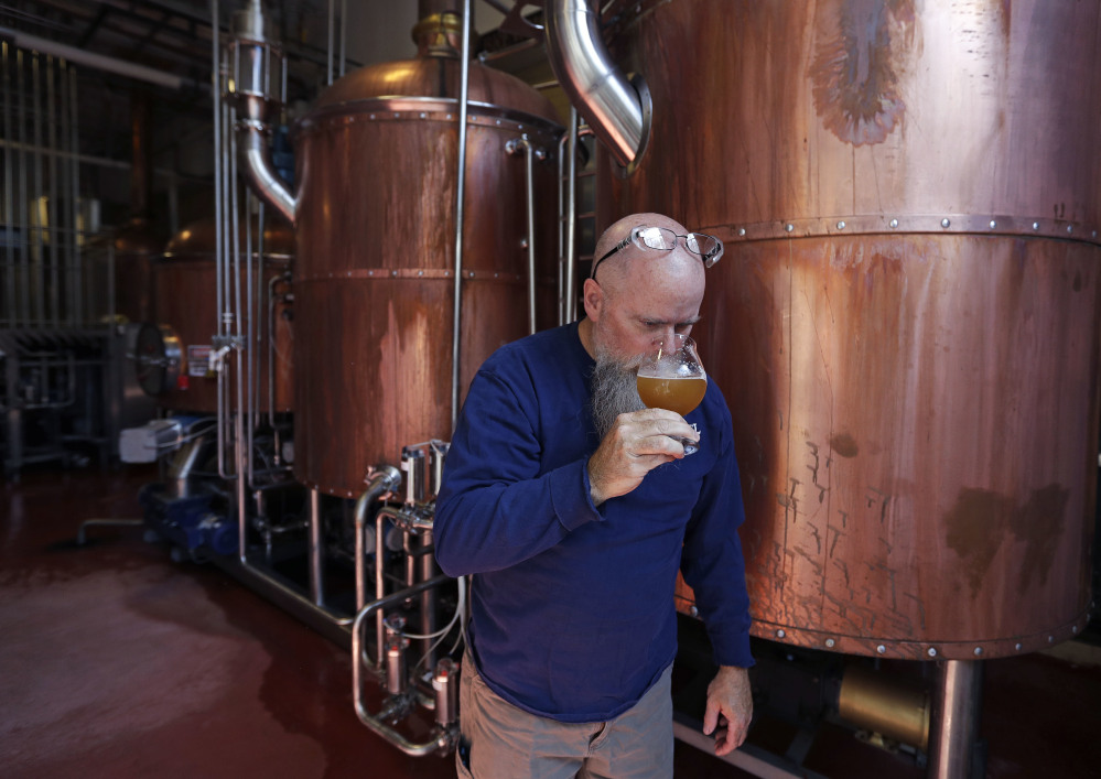 Bob Cannon, a master brewer at Samuel Adams, takes in the aroma of the company's entry in a brewing competition that is the highlight of HUBweek, a Boston-area festival celebrating innovation in art, science and technology.