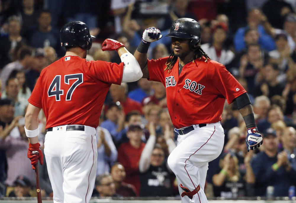 Hanley Ramirez, right, celebrates his home run with Travis Shaw in the fourth inning Friday night at Fenway Park.