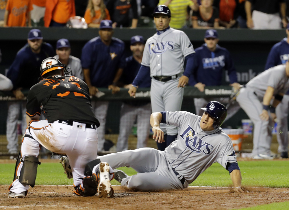 Baltimore catcher Matt Wieters ends the game as he tags out Tampa Bay's Mike Mahtook, attempting to score from first on a single, as the Orioles won 5-4 Friday at Baltimore.