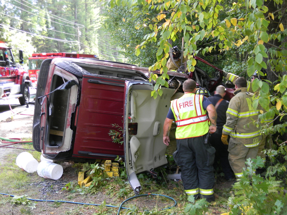 The Chevrolet Suburban lies off the side of Route 11 in Naples after Ruth Bliss, 48, drove it off the road and wrecked the vehicle early in the afternoon of Saturday, Sept. 17, 2016.