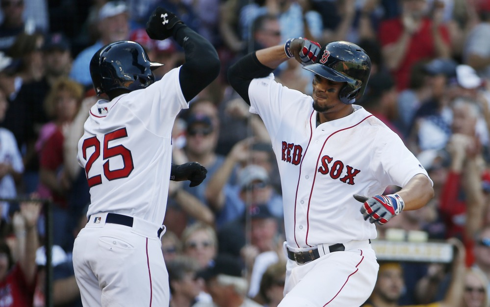 Boston's Xander Bogaerts, right, with Jackie Bradley Jr. after hitting a two-run home run in the fifth inning of the Red Sox' 6-5 win over the Yankees in Boston.