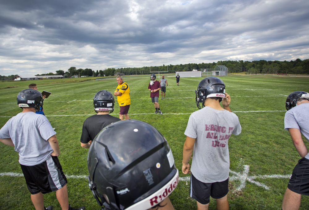Dave Higgins, head coach of the Greely High School football squad in Cumberland, sets up a special teams drill at a recent practice. Decreasing overall enrollment is the biggest factor behind the decline in football participation in Maine, though others attribute the diminished participation to heightened awareness about the dangers of head injuries.