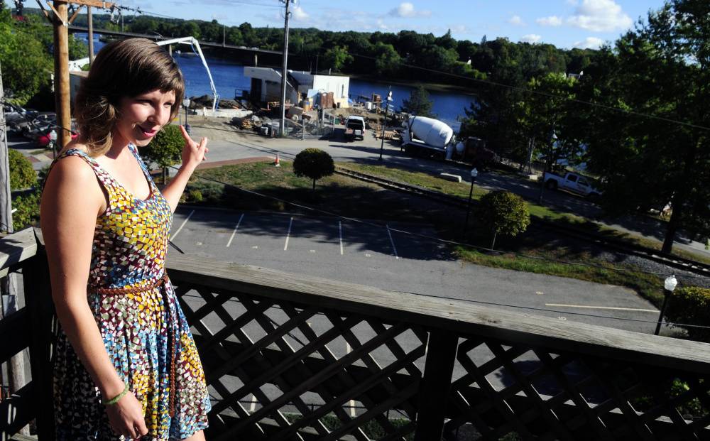 Community Outreach Director Tyler Kidder talks about views of the Kennebec River as she stands on the back deck of the new GrowSmart Maine office on Thursday in Gardiner.