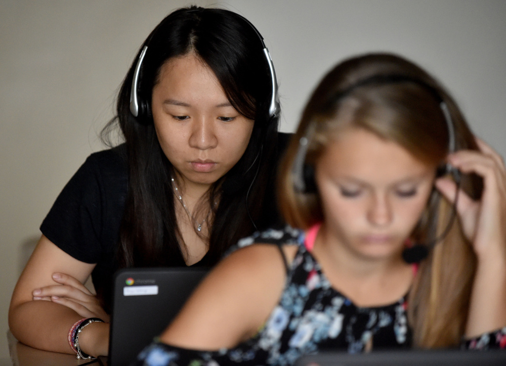 Paige Wong, a senior exchange student from Taiwan, works through Rosetta Stone lessons during Spanish class at Madison Area Memorial High School. She says she appreciates the program's focus on listening and conversation.
