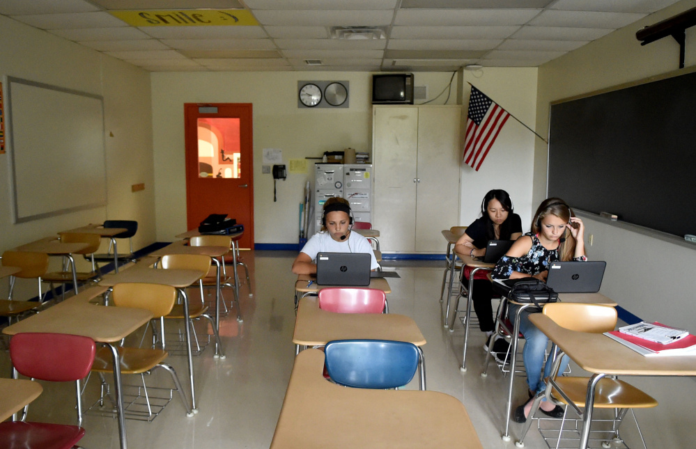 Students at Madison Area Memorial High School listen to their personal lessons using Rosetta Stone during foreign language class.