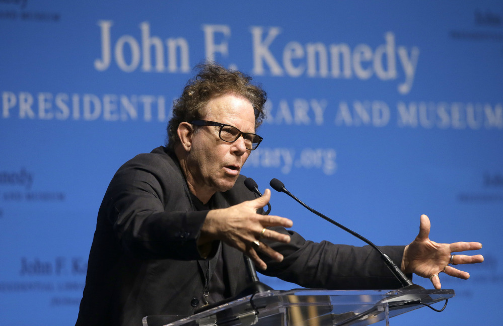 Tom Waits addresses an audience at the Song Lyrics of Literary Excellence Awards in Boston Monday, where he and his wife, Kathleen Brennan, and John Prine were honored.