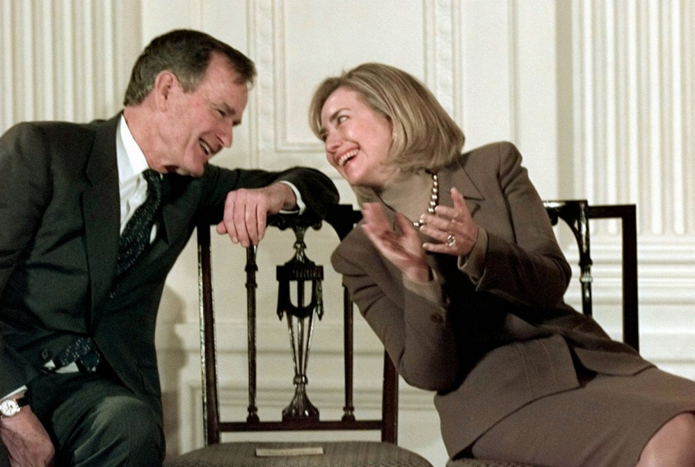 Former President George H.W. Bush and then-first lady Hillary Clinton converse at the White House in 1997. CNN reported that Bush told about 40 people meeting Monday in Kennebunkport that she will get his vote.
