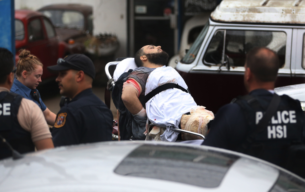 Ahmad Khan Rahami is taken into custody after a shootout with police Monday in Linden, N.J. He was charged Tuesday with planting explosives in New York and New Jersey.
