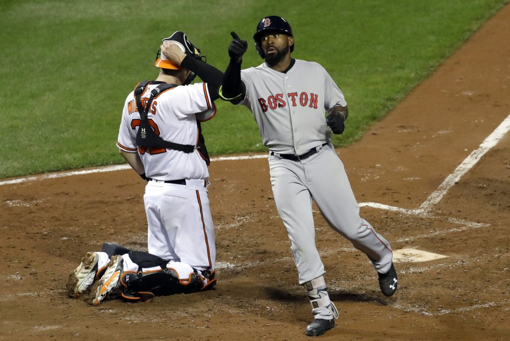 Jackie Bradley Jr. points into the stands after crossing home plate on his solo home run in the fourth inning.