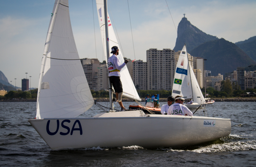 "Hugh Freund, left, looks back toward Rio de Janeiro, as he and crewmates Rick Doerr and Brad Kendell sail their keelboat. ""Sailing's a huge mental game,"" he said, noting ""We were in a tricky spot."" Will Ricketson/US Sailing"