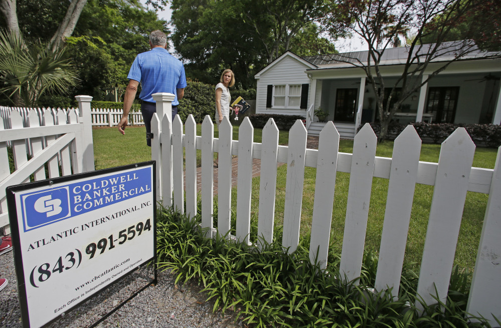 Real estate agent Lauren Newman prepares to show Steve Martin a home for sale last spring in Mount Pleasant, S.C. In the Maine housing market,