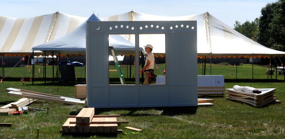 A vendor gets ready Wednesday for the Common Ground Country Fair in Unity, where 60,000 are expected and speakers will address urban farming and producing food locally.