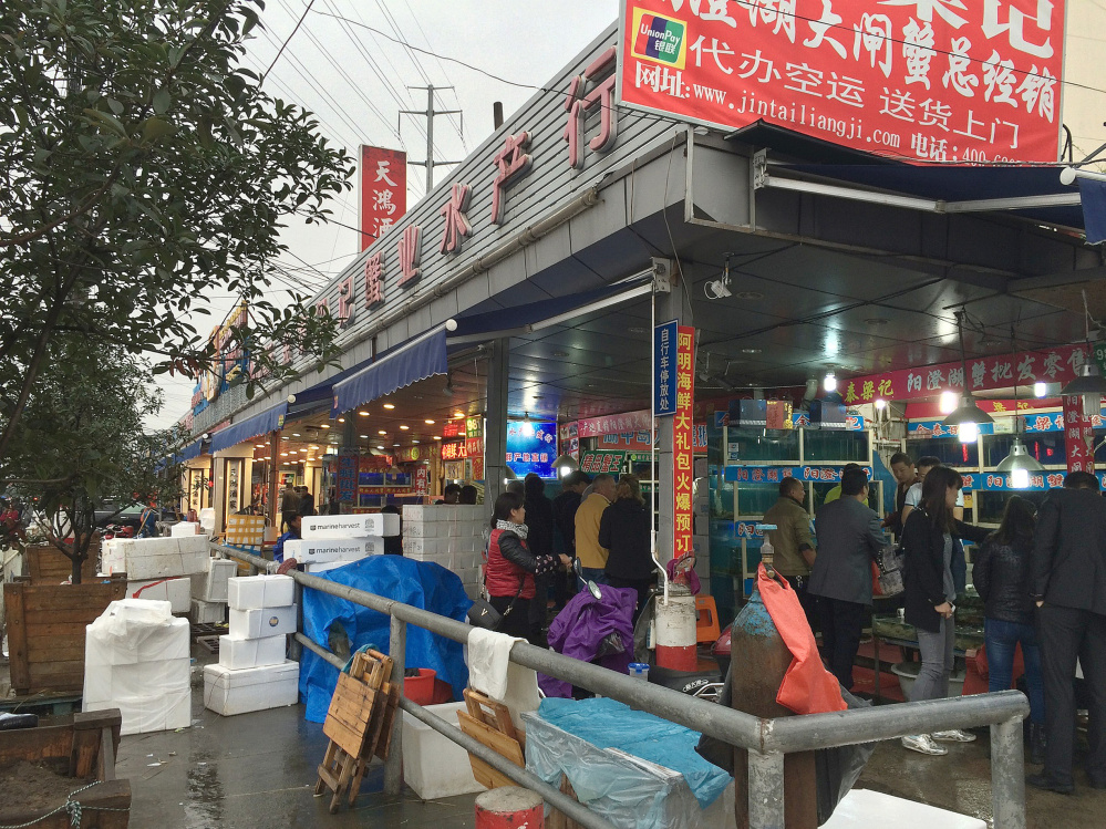 Boxed Maine lobsters sit outside a business in Shanghai in 2015. Officials from Maine companies such as Ready Seafood Co. and Maine Coast Co. have made numerous trips to Asia over the years, visiting clients and attending seafood trade shows to build their export business.