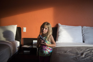 Arianna turns on the TV in a Motel 6 in Lewiston where Joe Dunne, their landlord, put up the family for a night because the apartment wasn't ready to move into.