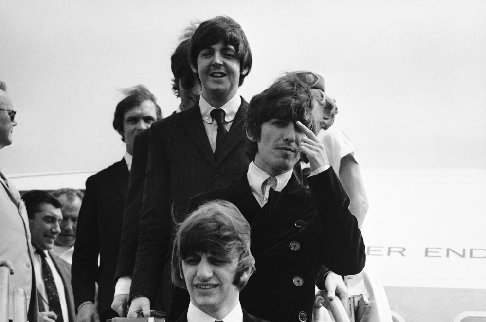 The Beatles deplane in Boston on Aug. 11, 1966, en route to Chicago, where they were to start their third American tour.