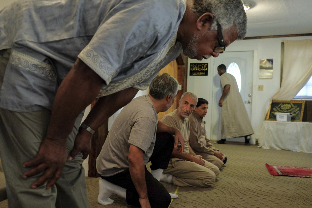Muslim men prepare to hold Friday afternoon prayers in a temporary worship space in Culpeper, Va. The group has had to put its plans to build a mosque on hold.