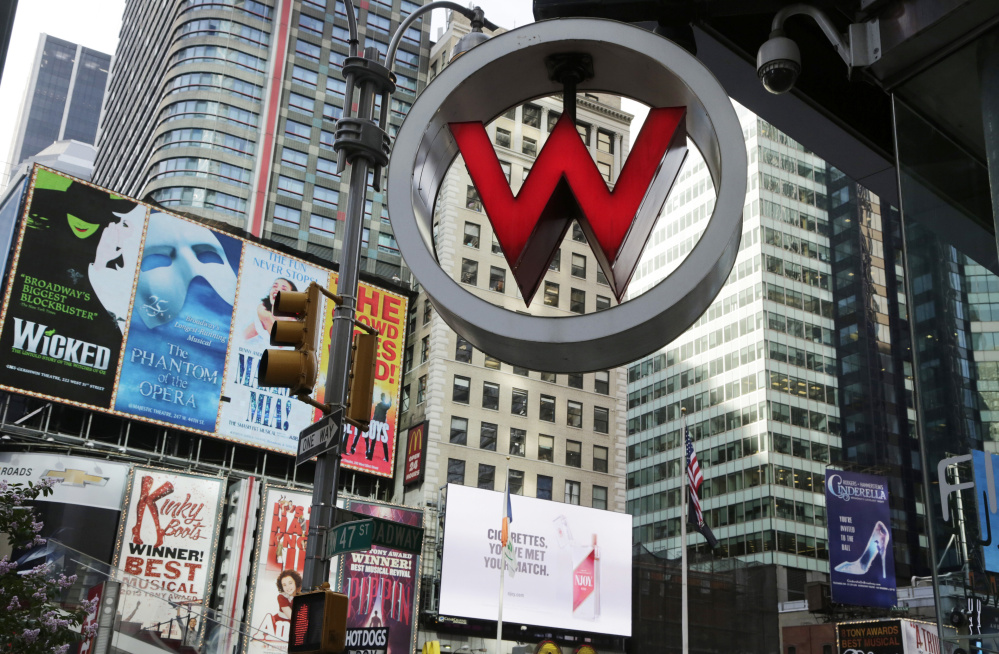 The logo for the W hotel hangs in New York's Times Square. The W hotel was owned by Starwood Hotels & Resorts Worldwide but now falls under the Marriott International umbrella.