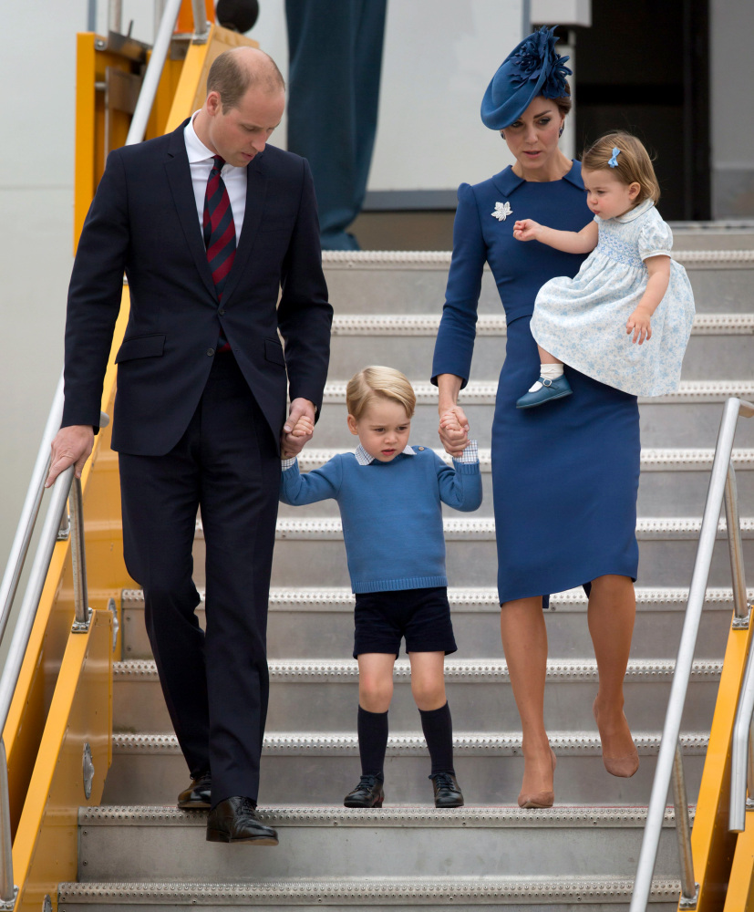 Britain's William and Kate, the Duke and Duchess of Cambridge, along with their children Prince George and Princess Charlotte step off the plane Saturday in Victoria, British Columbia.