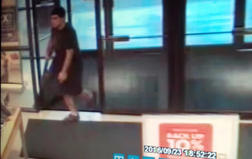 The suspect in a fatal shooting rampage Friday at the Cascade Mall in Burlington, Wash., is seen in a surveillance video image. Authorities said Arcan Cetin appeared to be