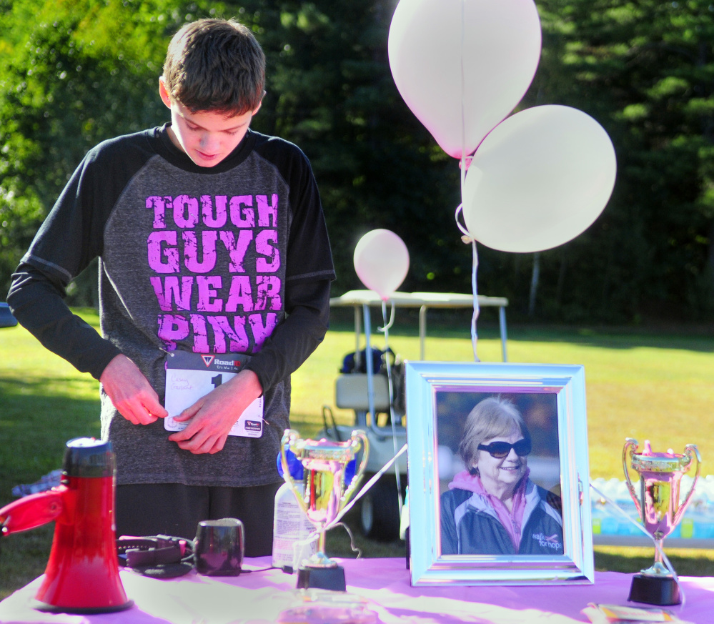 Casey Gallant, with a framed photo of his late grandmother Lois Lajoie, raised $4,500 to fight breast cancer.