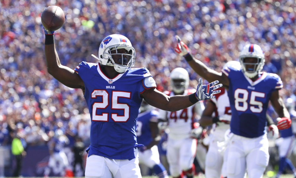 LeSean McCoy celebrates after one of his two touchdowns Sunday during Buffalo's 33-18 win over the Arizona Cardinals in Orchard Park, N.Y.