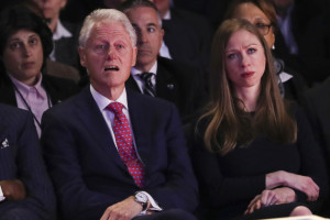 Former President Bill Clinton and Chelsea Clinton watch the debate.