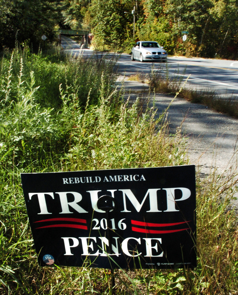 This political sign for Donald Trump and Mike Pence is placed along North Street in Waterville, a short distance from the Colby College campus property on Monday.