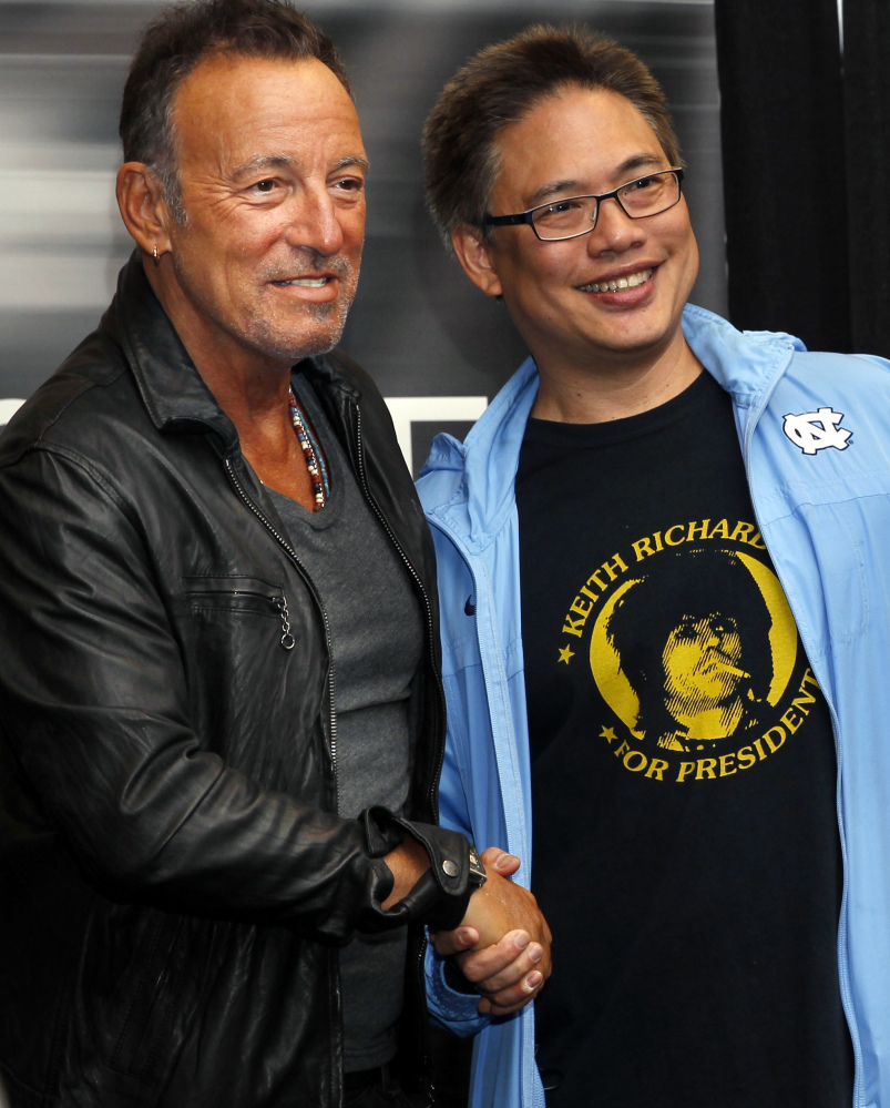 Bruce Springsteen greets a fan Tuesday at his book launch in Freehold. N.J.