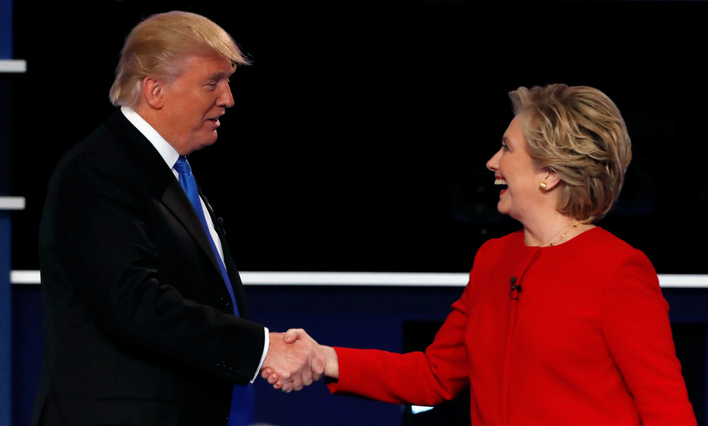 Presidential candidates Republican Donald Trump and Democrat Hillary Clinton shake hands at the end of their first debate at Hofstra University in Hempstead, N.Y., on Monday. The debate format was not ideal for Trump.