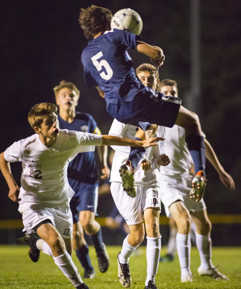 York's Zach Westman leaps to head the ball against Greely in Tuesday's game. York won 3-0 to improve to 5-3.   Ben McCann/Staff Photographer