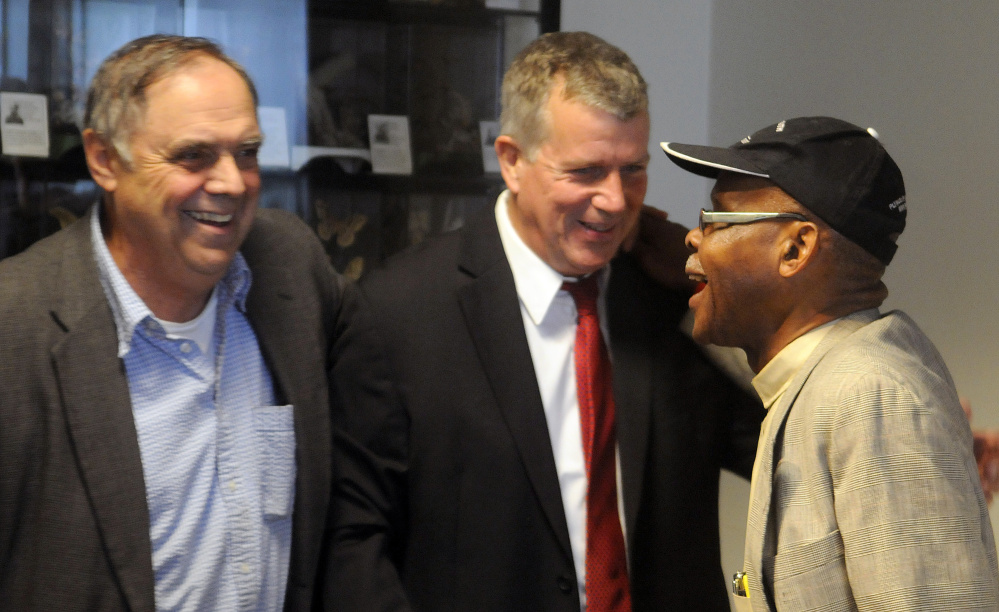 The Rev. Steven Craft, right, greets Hal Shurtleff, center, director of New Hampshire's Camp Constitution, and Paul Madore, a conservative activist, before a news conference Wednesday in Augusta to discuss remarks that Gov. Paul LePage made regarding the race of people charged with drug crimes.