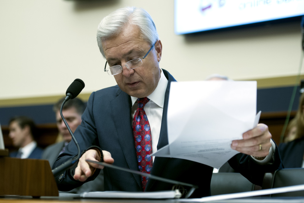 Wells Fargo CEO John Stumpf goes over his notes as he testifies on Capitol Hill in Washington Thursday before the House Financial Services Committee investigating Wells Fargo's opening of unauthorized customer accounts.