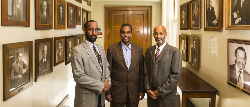 Immigrant leaders gather in City Hall after announcing the launch of New Mainers Alliance. From left: Mahmoud Hassan, the new group's co-founder and president of Somali Community Center of Maine; Abdifatah Ahmed, chairman of the alliance; and Elmuatz Abdelrahim, co-founder of the alliance.