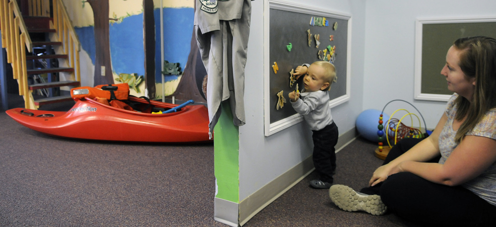 Archer White, 1, plays Thursday with his mother, Jamie, at the Children's Discovery Museum in Augusta. The museum, which started in 1984 as a series of traveling exhibits, has announced it is relocating to Waterville.