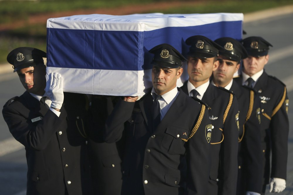 Members of the Knesset guard carry the coffin of former Israeli President Shimon Peres in Jerusalem on Thursday. Peres died early Wednesday from complications from a stroke. He was 93.