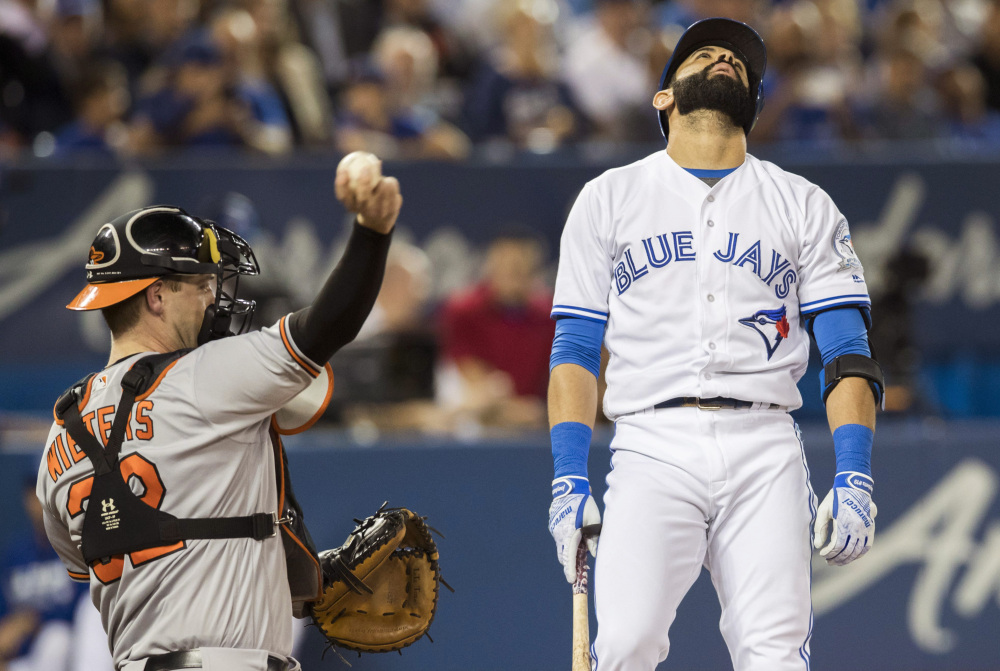 Toronto's Jose Bautista reacts in frustration as Baltimore catcher Matt Wieters tosses the ball back after Bautista struck out during the Blue Jays' 4-0 loss to the Orioles Thursday at Toronto.