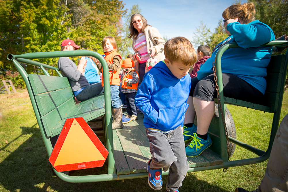 Charli Myrick of Pittsfield carefully exits a hayride as Madalyn Ring, a teacher at the Pittsfield-Manson Pre-K school, watches.