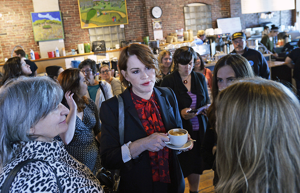 Actress Molly Ringwald talks with Hillary Clinton supporters at Arabica Coffee House on Commercial Street in Portland Tuesday. She also had stops to make at a voter registration drive, a phone bank event and happy hour at Portland Hunt & Alpine Club.
