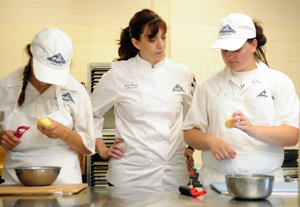 Chef Heidi Parent, center, who will appear on season 16 of
