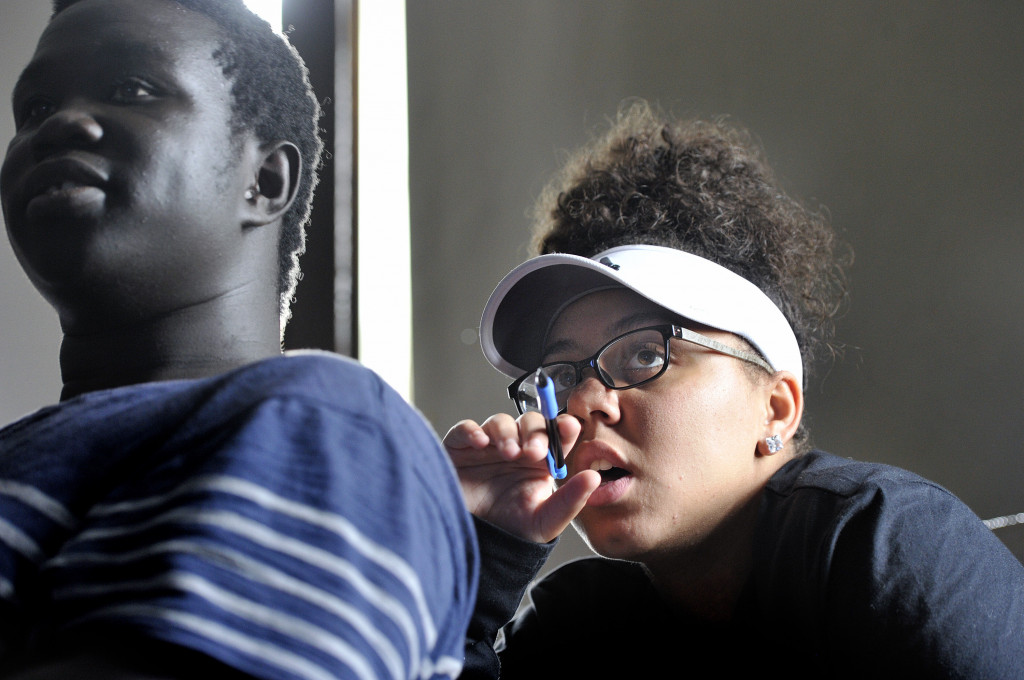 Ochan Ogak, left and Tasha Tracy, both juniors in Sally Reagan's Modern US and World History class at Portland High School, pay attention as the class discusses terrorism on Thursday, Sept. 8. (Photo by Shawn Patrick Ouellette/Staff Photographer)