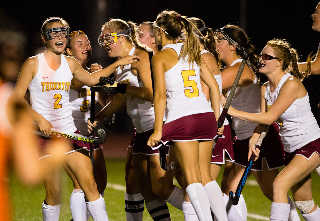 Thornton Academy's Grace Decker is congratulated by teammates after scoring on a first-half penalty shot, the Trojans' first of six goals goal against Biddeford.  Carl D. Walsh/Staff Photographer