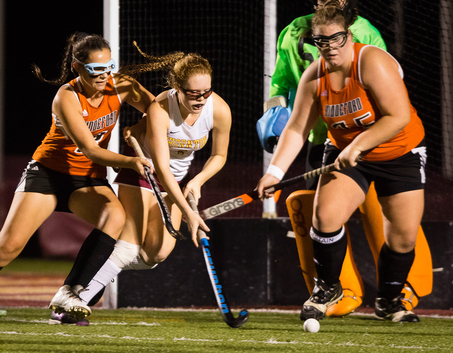 Thornton Academy forward Taylor Ouellette controls the ball in front of the Biddeford goal as Biddeford's Peyton McKeown, left, and Paige Boudreau defend. Carl D. Walsh/Staff Photographer