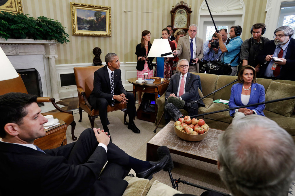 Speaker of the House Paul Ryan, R-Wis., left front, listens next to Senate Majority Leader Mitch McConnell, R-Ky., as President Barack Obama speaks next to Senate Democratic Leader Harry Reid, of Nevada, and House Democratic Leader Nancy Pelosi, of Calif., in the Oval Office of the White House Monday.