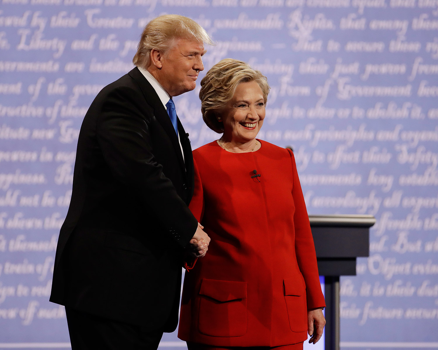 Hillary Clinton and Donald Trump shake hands before Monday night's presidential debate at Hofstra University in Hempstead, N.Y.